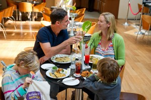 A family relaxing together over a meal at the Sofitel.
